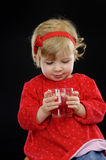 Little girl drinking juice, Royalty Free Stock Photography