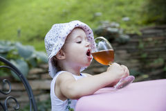 Little girl drinking juice Royalty Free Stock Photo