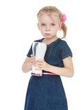 Little girl drinking from a large glass of milk Royalty Free Stock Photos