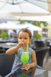 Little girl is drinking  lemonade with mint Stock Photo