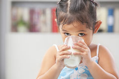 Little girl drinking milk Stock Image