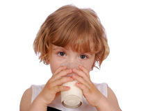 Little girl drinking milk Stock Photos