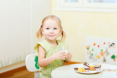 Little girl drinking milk Royalty Free Stock Photography