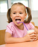 Little girl is drinking milk Royalty Free Stock Photos