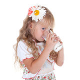 Little girl drinking milk. Isolated on white background royalty free stock image