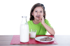 Little girl drinking milk and cookies Royalty Free Stock Photography
