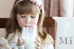 Little girl is drinking milk Royalty Free Stock Image