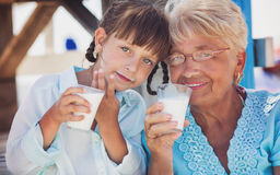 Little girl is drinking milk Stock Photography