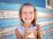Little girl is drinking milk Royalty Free Stock Photography