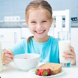 Little girl drinking milk Stock Photo