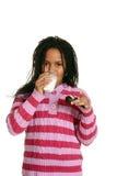 Little girl drinking milk Stock Photos