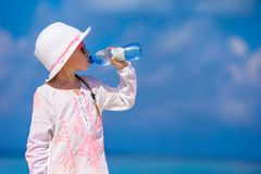 Little girl drinking mineral bottle of water at Royalty Free Stock Images