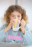 Little girl drinking from mug Royalty Free Stock Photos