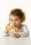 Little girl drinking orange juice Royalty Free Stock Image