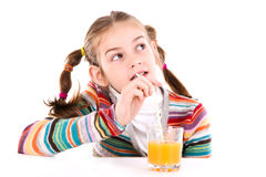 Little girl drinking orange juice Royalty Free Stock Images