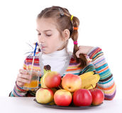 Little girl drinking orange juice Royalty Free Stock Photography