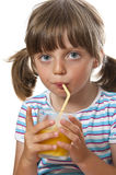 Little girl drinking orange juice Royalty Free Stock Photo