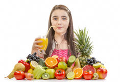 Little girl drinking orange juice Stock Photo