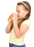 Little girl is drinking orange juice Royalty Free Stock Photography