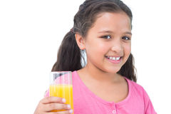 Little girl drinking orange juice Stock Photo