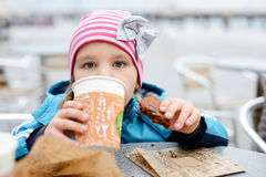 Little girl drinking outdoors Stock Photography