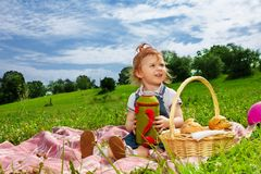 Little girl drinking on picnic royalty free stock images