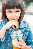 Little girl drinking a smoothie Stock Photos