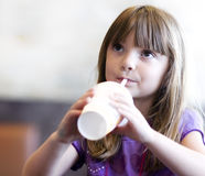 Little girl drinking soda pop Stock Photography