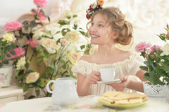 Little girl drinking tea Stock Image