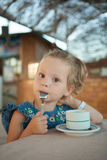 Little girl drinking tea from a cup Stock Photo