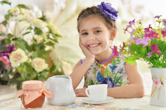 Little girl drinking tea Royalty Free Stock Images