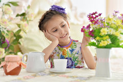Little girl drinking tea Stock Images