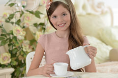 Little girl drinking tea Stock Photography