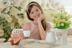 Little girl drinking tea. Portrait of a beautiful little girl drinking tea Stock Photography