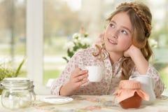 Little girl drinking tea. Portrait of a beautiful little girl drinking tea Royalty Free Stock Photo