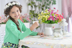 Little girl drinking tea Royalty Free Stock Photos