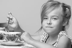 Little girl is drinking tea Royalty Free Stock Photo