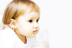 Little girl drinking water Stock Image