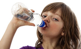 A little girl drinking water. Isolated Stock Image