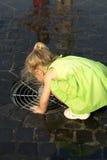 Little girl drinking water stock photos