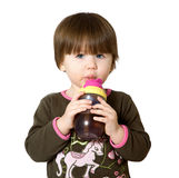 A little girl drinking water. Stock Image