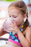 Little girl drinking water. Adorable little girl drinking water from a glass Royalty Free Stock Photography