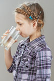 Little girl is drinking water Royalty Free Stock Images