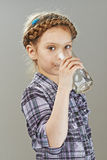 Little girl is drinking water Stock Images