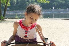 A little girl is drinking water in the heat Stock Photo