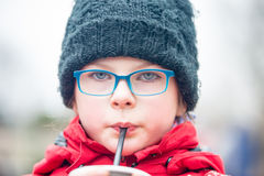 little girl drinking water outdoors Stock Photo