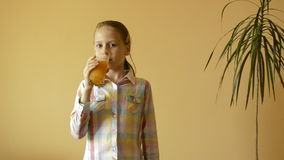 Little girl drinks juice stock video