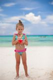 Little girl drinks juice from watermelon on the Stock Image