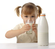 Little girl drinks milk Royalty Free Stock Photography