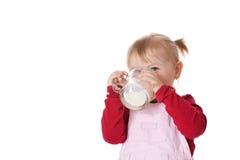 Little girl drinks milk Royalty Free Stock Images
